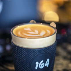 Flat White in a Takeaway Cup at Cafe 164 Leeds