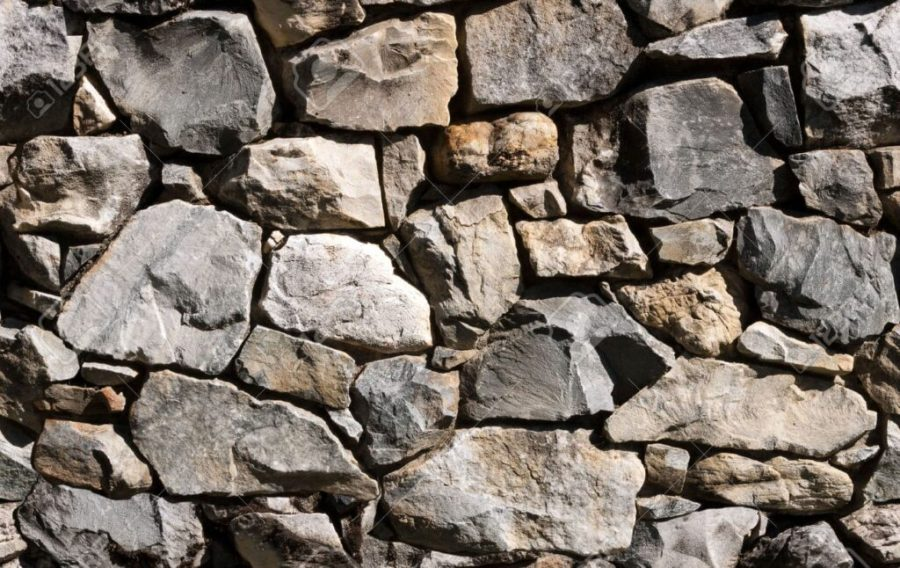 Seamless natural rubble rockwall background, use as stand alone image or as repeating tile.