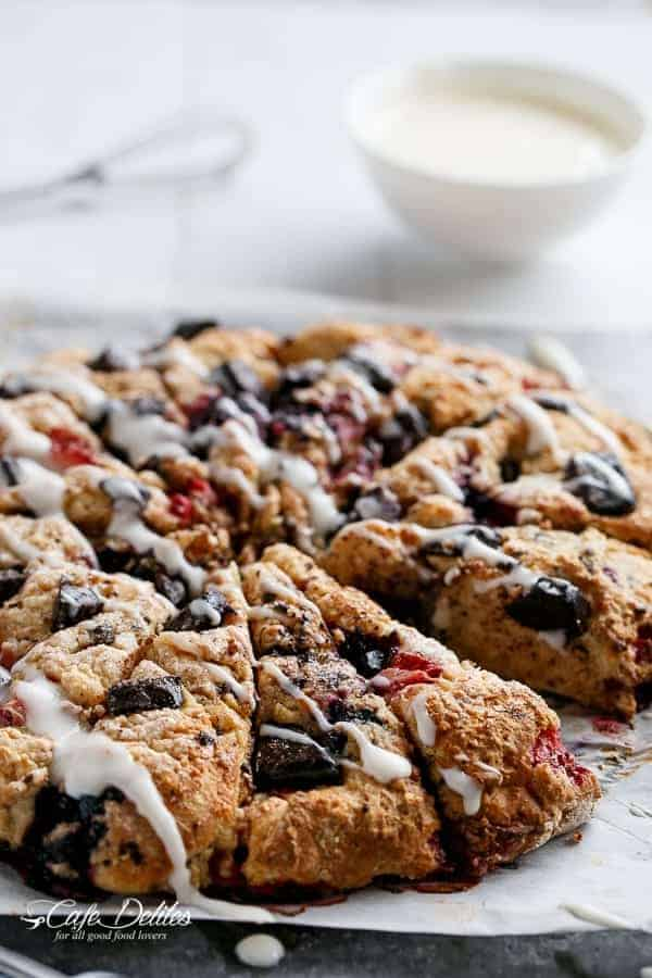 Mixed Berry and Chocolate Chunk Buttermilk Scones with a Cream Cheese Glaze | https://cafedelites.com