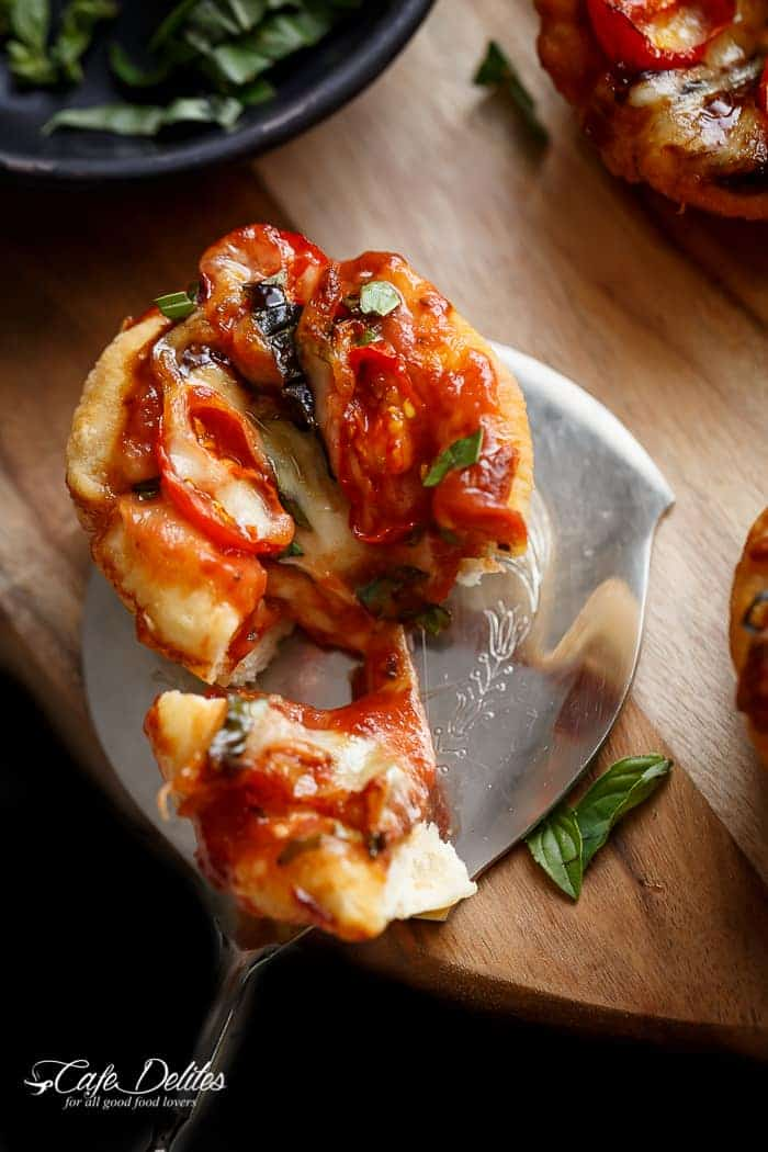Caprese salad meets pizza in these delicious deep dish pizzas made easy in a humble standard muffin pan| http://cafedelites.com