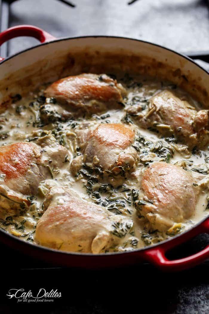 Creamy Spinach Artichoke Chicken Thighs in one skillet! Low fat AND low carb, filled with fresh spinach, artichokes, parmesan cheese and a hint of garlic!   https://cafedelites.com
