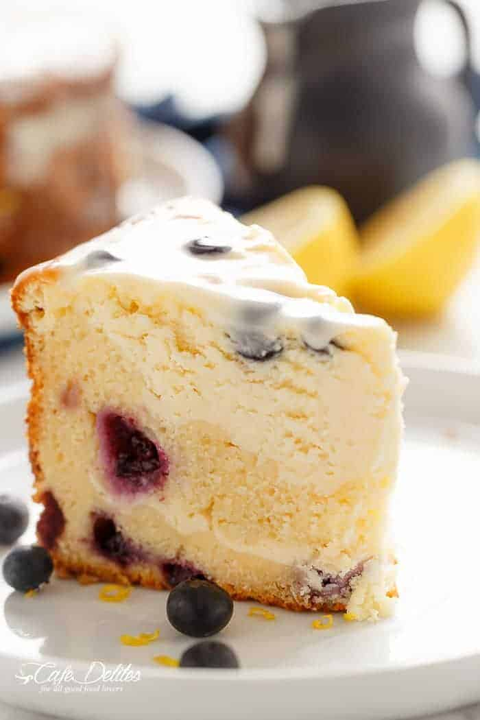 Blueberry Lemon Cheesecake Cake   https://cafedelites.com