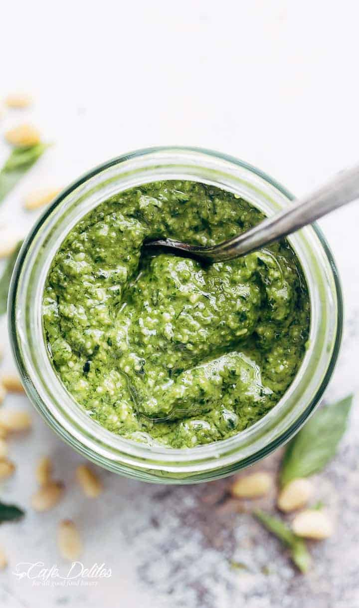 Fresh, homemade basil pesto is way better than any store bought pesto, with a flavour-packed punch! All you need is 5 ingredients and a food processor! | https://cafedelites.com