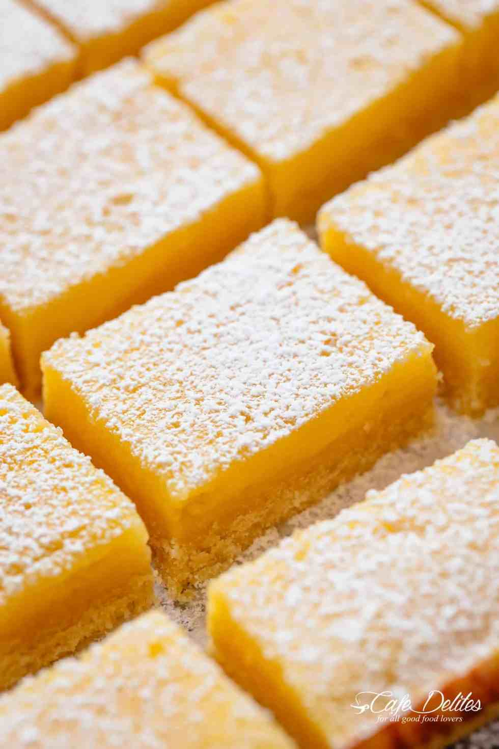 101 calorie Lightened Up Lemon Bars are the perfect dessert and taste so sinful without the guilt! You won't believe they're lightened up! | https://cafedelites.com