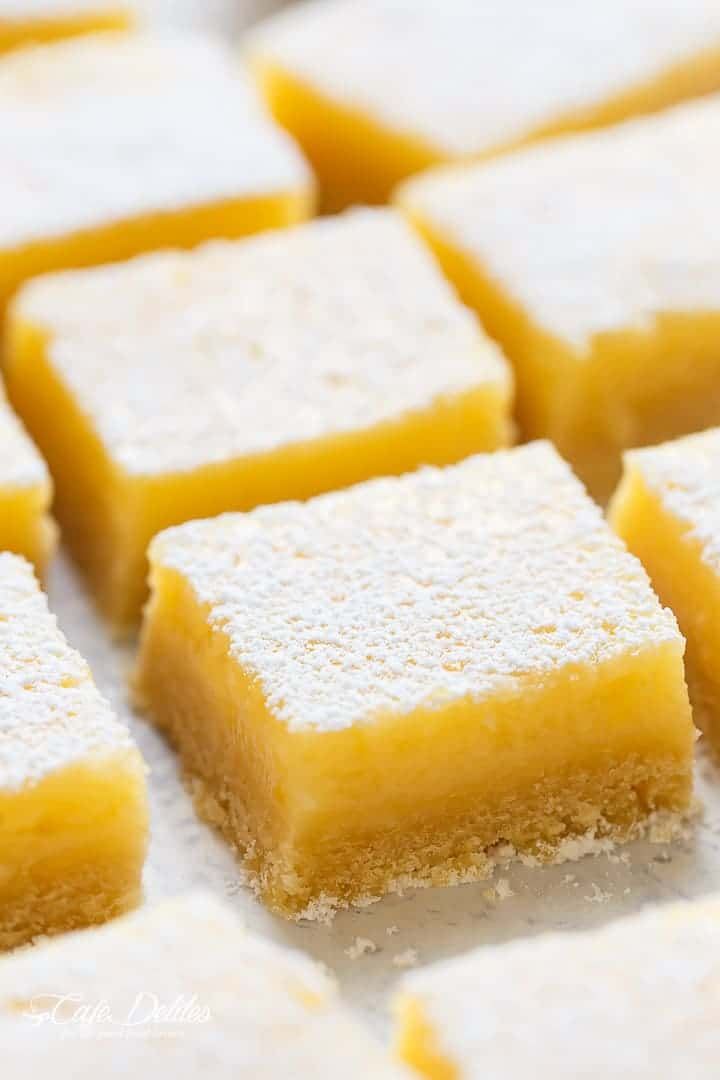 101 calorie Lightened Up Lemon Bars are the perfect dessert and taste so sinful without the guilt! You won't believe they're lightened up!   http://cafedelites.com