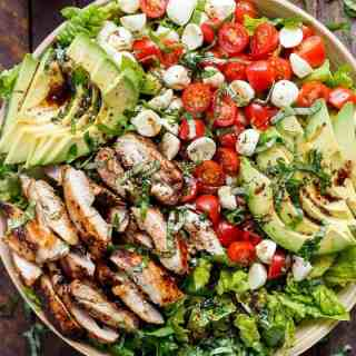 Balsamic Chicken Avocado Caprese Salad is a quick and easy meal in a salad drizzled with a balsamic dressing that doubles as a marinade!   http://cafedelites.com