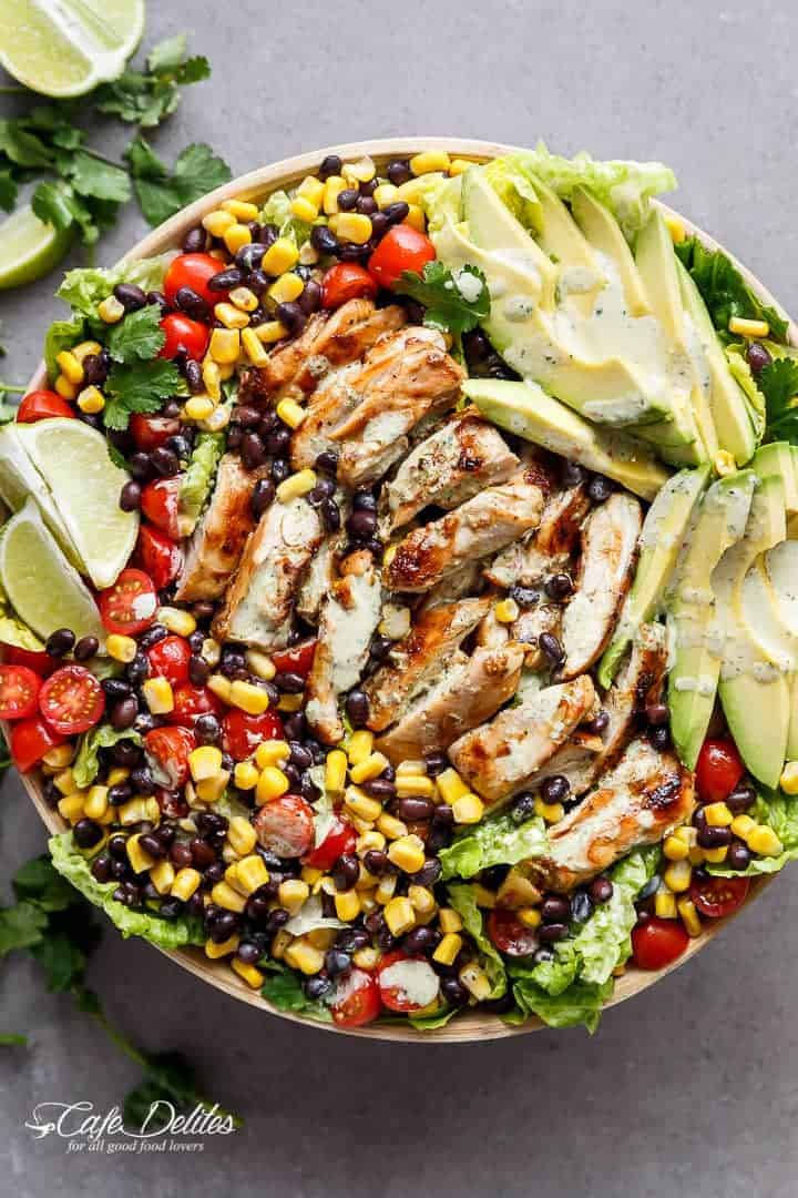 A Chili Lime Southwestern Chicken Salad with a low fat and CREAMY Cilantro Chili Lime Dressing that doubles as a marinade! | https://cafedelites.com