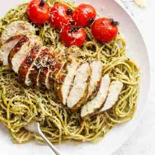 Basil Pesto Chicken Spaghetti is packed with flavour and comes together so quickly. It's sure to become a week-night favourite! | http://cafedelites.com