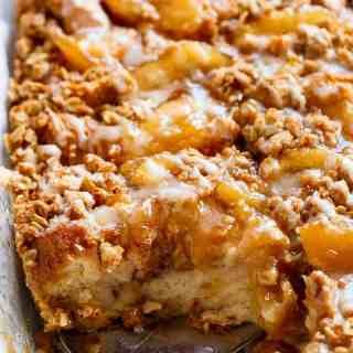 TWO desserts collide into one irresistible breakfast with this Apple Pie French Toast Bake! This casserole, also known as bread pudding, is a family favourite breakfast! | http://cafedelites.com