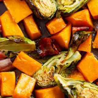 Honey Roasted Butternut Squash & Brussels Sprouts With Crispy Bacon Pieces in a simple 2 ingredient coating for roasting! | http://cafedelites.com