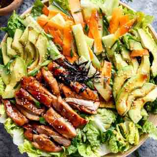 Teriyaki Glazed Chicken Salad complete with avocado, cucumbers, carrots and thin strips of seaweed for real sushi lovers! Drizzled with an incredibly easy teriyaki dressing that doubles as a marinade! | http://cafedelites.com