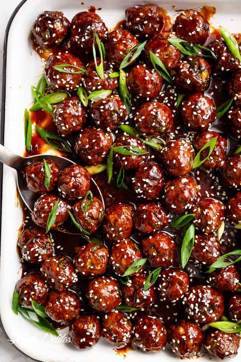 Tender Mongolian Glazed Meatballs are not only FILLED with Asian flavour -- they are smothered in the BEST homemade Mongolian sauce to wow your guests!   https://cafedelites.com