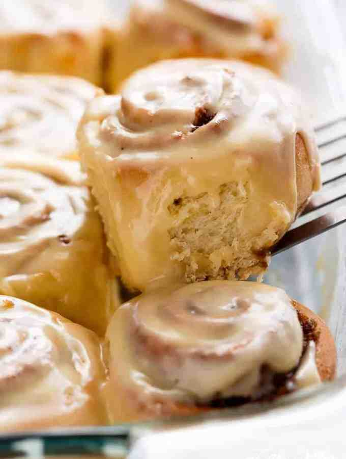 Quick Soft Cinnamon Rolls with a cream cheese glaze are super fluffy and light with a simple homemade dough, and a quick method to get baking! | http://cafedelites.com