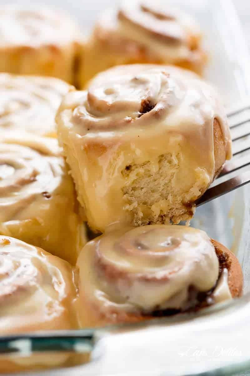 Quick Soft Cinnamon Rolls with a cream cheese glaze are super fluffy and light with a simple homemade dough, and a quick method to get baking! | https://cafedelites.com