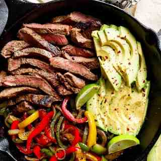 Chili Lime Steak Fajitas are so juicy and full of incredible flavours! The secret lies in this incredibly popular marinade!   http://cafedelites.com