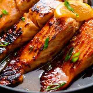 Crispy Honey Orange Glazed Salmon fillets are pan-fried in the most beautiful honey-orange-garlic sauce, with a splash of soy for added flavour! | http://cafedelites.com