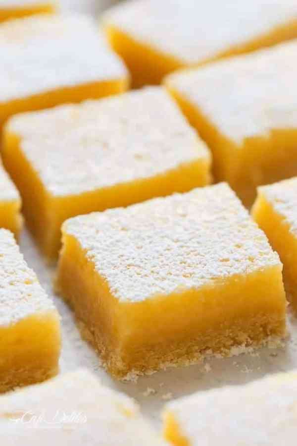 101 calorie Lightened Up Lemon Bars are the perfect dessert and taste so sinful without the guilt! You won't believe they're lightened up! | http://cafedelites.com