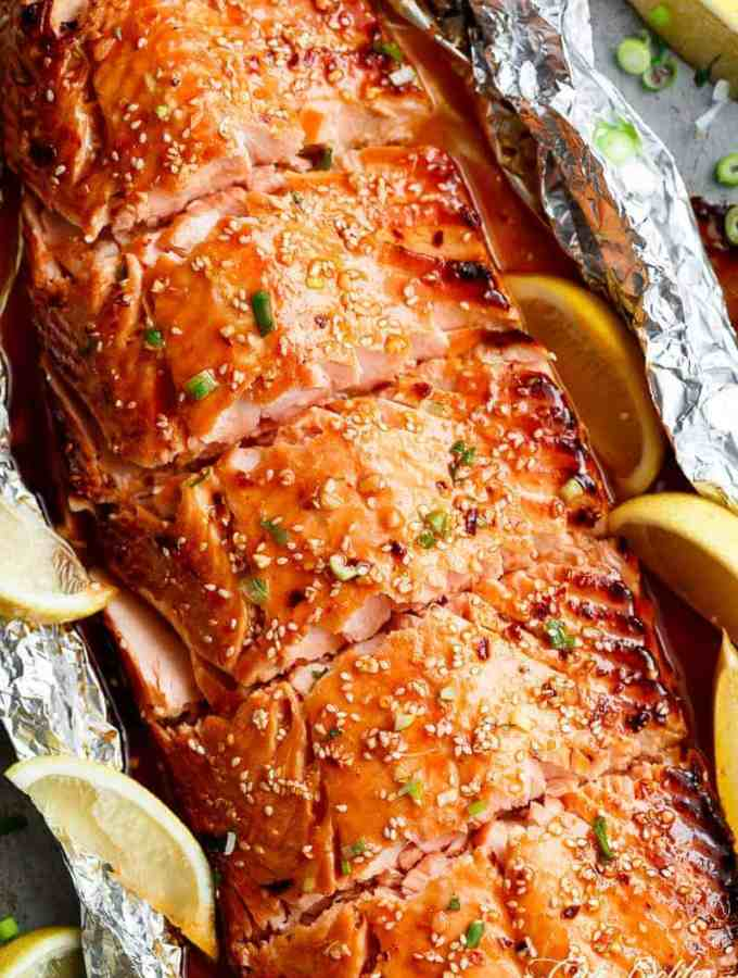 Honey Sesame Salmon In Foil is ready in under 20 minutes! Full of Asian flavours with ingredients you have in your kitchen, and so easy to pull together! | https://cafedelites.com
