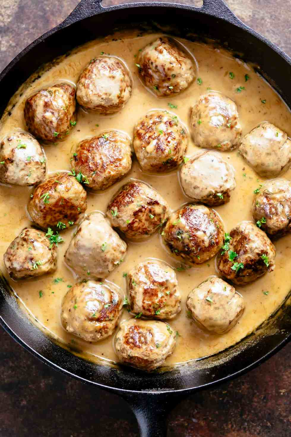 The best Swedish meatballs recipe you'll ever try, swimming in a delicious gravy sauce! | https://cafedelites.com