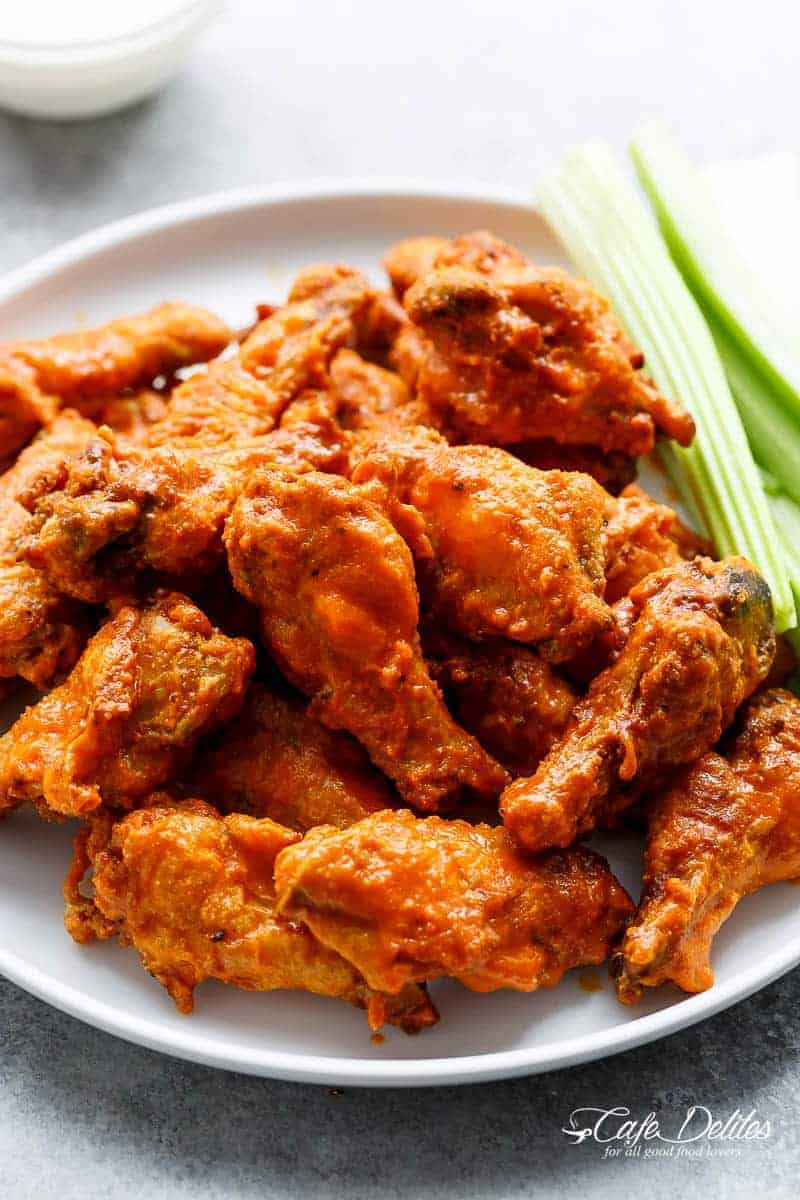 Crispy Buffalo Chicken Wings are exactly what they claim to be. CRISPY without deep frying, using one special ingredient you have in your kitchen pantry!   https://cafedelites.com