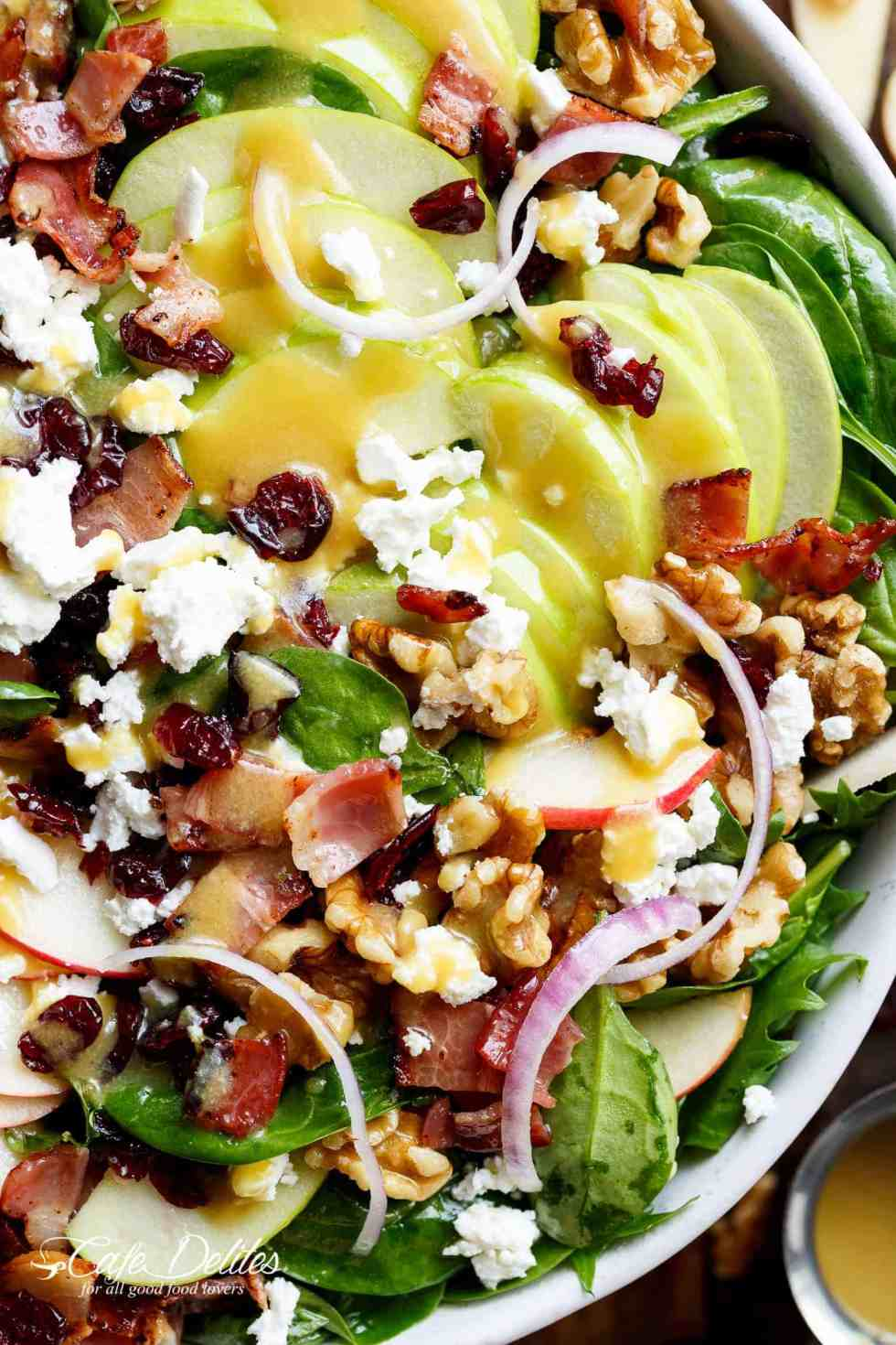 Honey Dijon Apple Bacon Cranberry Salad screams FALL! Cranberries, Spinach, Walnuts And BACON! All drizzled with the most perfect Honey Dijon Dressing! | Cafe Delites