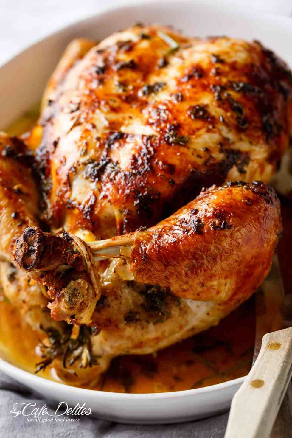 Garlic Herb Butter Roast Chicken packed with unbelievable flavours, crispy skin, and so juicy! | cafedelites.com