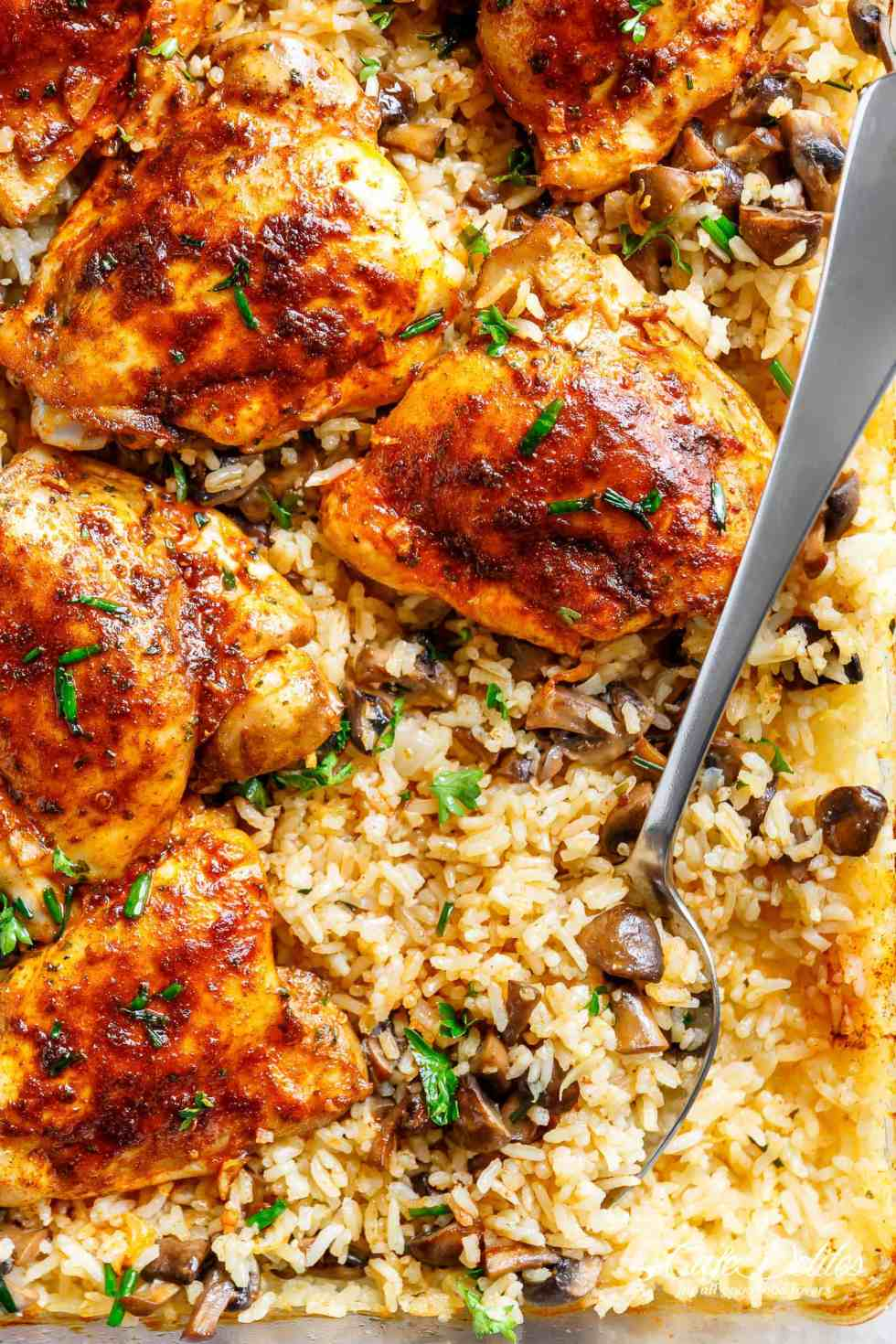 Easy Oven Baked Chicken And Rice With Garlic Butter Mushrooms mixed through is winner of a chicken dinner! Chicken thighs bake on top of buttery, garlicky, soft and tenderrice with crispy edges.ALL the chicken flavours bake right in! Dinner doesn't get any easier! | cafedelites.com
