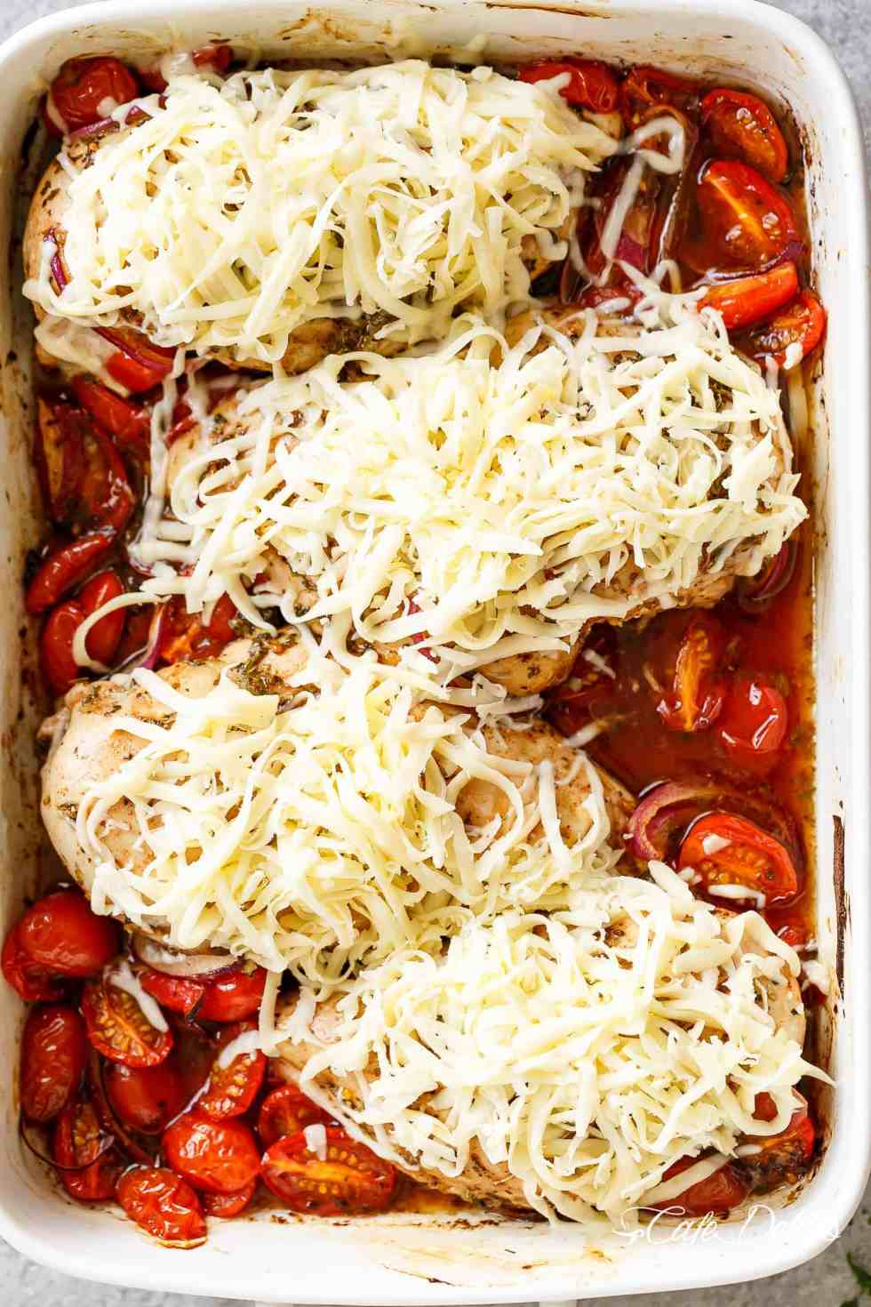 Balsamic Baked Chicken Breast rubbed with garlic and herbs, dripping with a tomato balsamic sauce and melted mozzarella cheese! EASY chicken recipe! | https://cafedelites.com