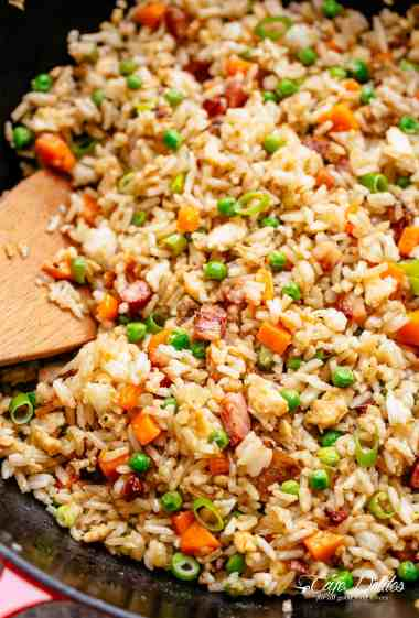 Fried Rice withcrispy bacon and fluffy eggs is better than take out and so easy to make! Why go out when you can have the best fried rice right at home! Just like Chinese take out fried rice. Perfect for when you have leftover rice OR make it quick from scratch with a few tricks! | cafedelites.com