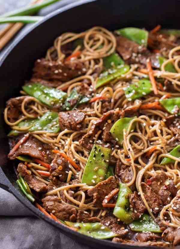 Skillet full of stir fry and ramen noodles