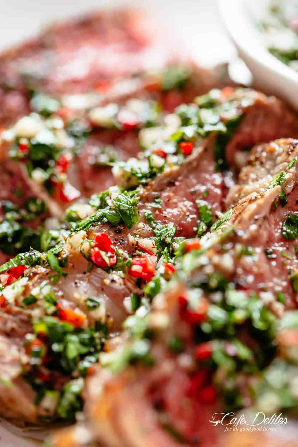 Chimichurri is the most delicious silky condiment that drips over your steak, chicken or fish. Super easy to make and tastes incredible!   cafedelites.com