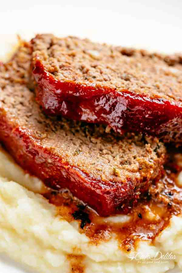 How to make the best tender and juicy Meatloaf with a delicious shiny glaze!Cheap, easy and quick to prepare, let the oven do all the work for you! The whole family goes crazy over each slice of this meatloaf recipe. PLUS... take advantage of leftovers and turn them into the best meatloaf sandwiches! | cafedelites.com