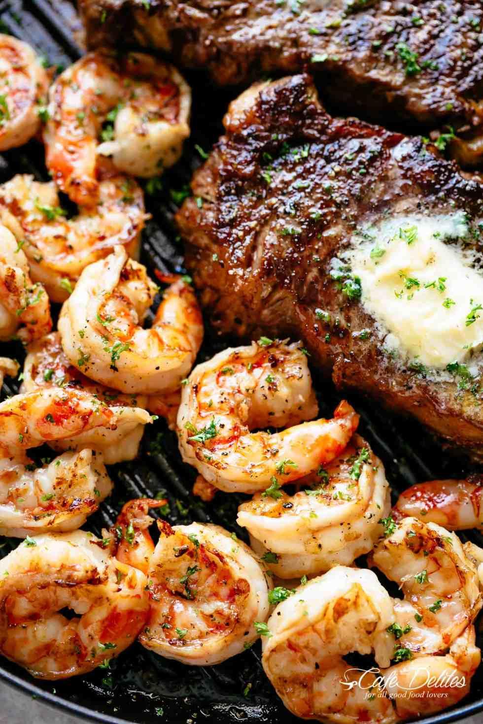Grilled Steak & Shrimp slathered in garlic butter | cafedelites.com
