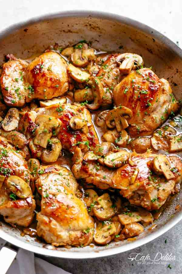 Golden seared chicken thighs in a delicious, buttery garlic mushroom sauce with a sprinkle of herbs is THE weeknight dinner everyone raves about! Serve over rice, pasta, mashed potatoes OR lower carb options like mashed cauliflower or zucchini noodles! | cafedelites.com