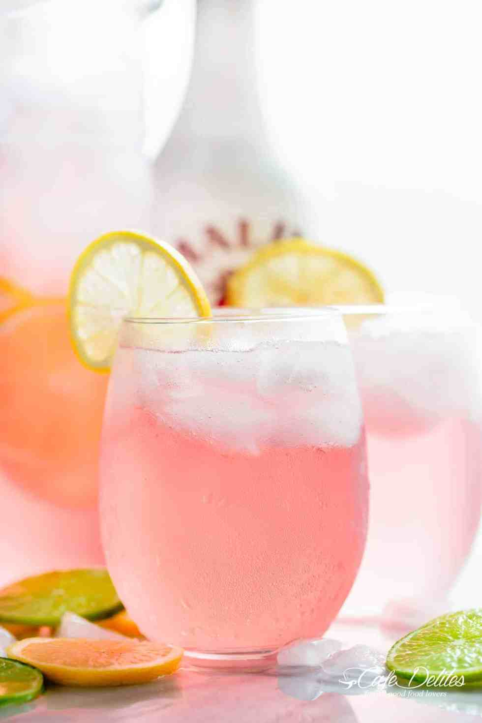Pink Vodka Lemonade with a splash of Malibu and lime juice to get your party started! | cafedelites.com