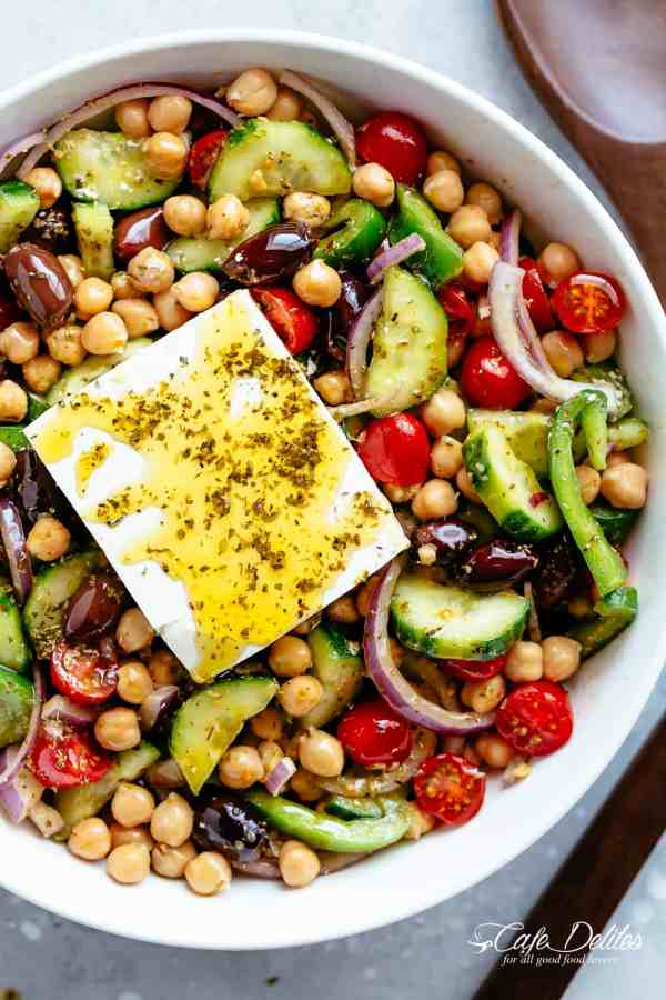 GreekChickpeaSalad with an authentic greek salad dressing is a favourite salad to serve as a main OR as a side! Healthy and filling! | cafedelites.com