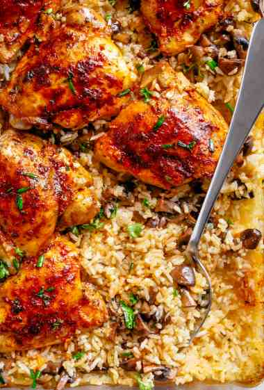 Easy Oven Baked Chicken And Rice With Garlic Butter Mushrooms mixed through is winner of a chicken dinner! | cafedelites.com