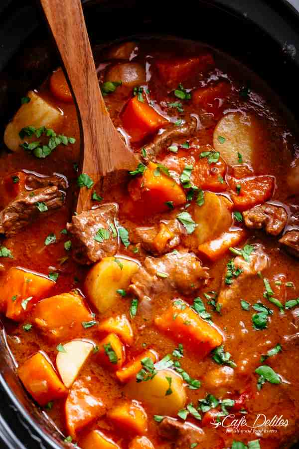 Slow Cooker Beef Stew is easy to throw together and filled with fall apart, tender beef pieces and sweet potato! | https://cafedelites.com