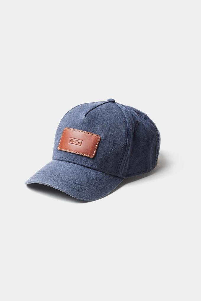 Blue cap with leather brown patch