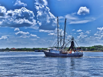 Shrimp Boat Heading to Sea
