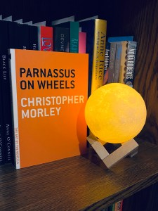 Picture of Parnassus on Wheels next to a moon lamp