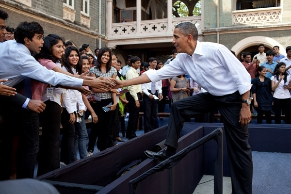 President Barack Obama greets students following a town hall meeting at St. Xavier College in Mumbai, India, Nov. 7, 2010. (Official White House Photo by Pete Souza) This official White House photograph is being made available only for publication by news organizations and/or for personal use printing by the subject(s) of the photograph. The photograph may not be manipulated in any way and may not be used in commercial or political materials, advertisements, emails, products, promotions that in any way suggests approval or endorsement of the President, the First Family, or the White House.