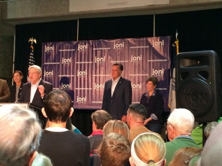 Governor Terry Branstad speaks while Lt. Gov. Kim Reynolds, former Gov. Mitt Romney and Joni Ernst  watch.