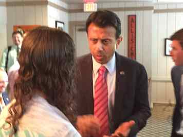 Bobby Jindal talking to another voter at the Machine Shed.