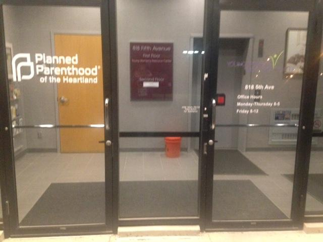 Signs on the doorway indicate just how close the two organizations are.