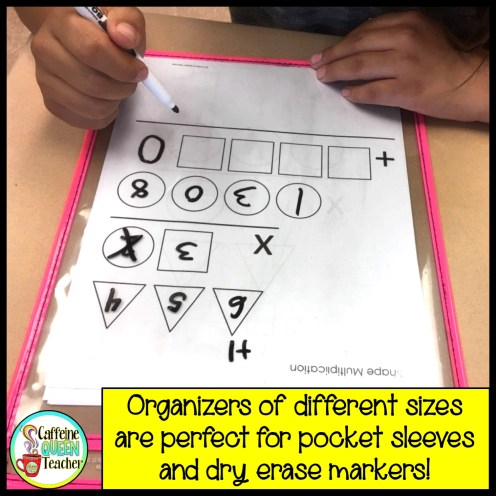 Multi-digit multiplication organizer inside a plastic pocket sleeve for classroom practice