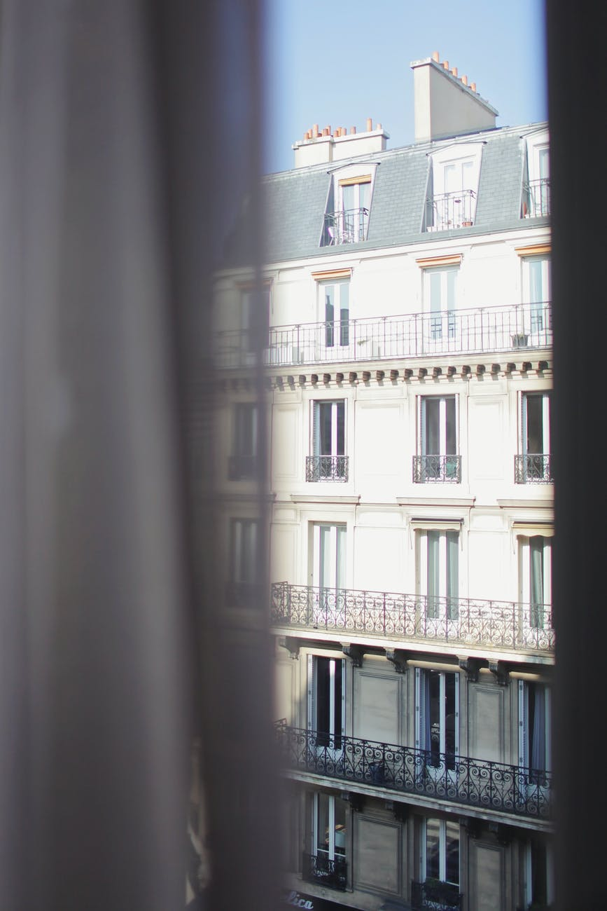 through window view of hotel on bright day