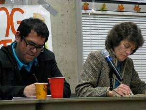 Carlos Marentes and Carol Thompson reflect and take notes during the opening panel