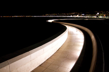 lit walkway on the edge of the sea