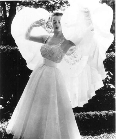 Capucine wearing Hubert de Givenchy, 1952